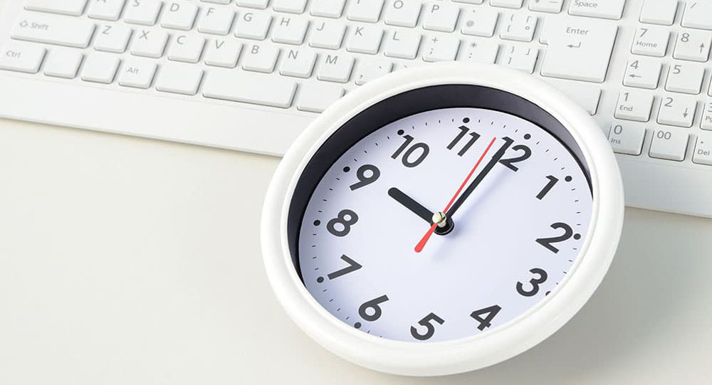 Image of a clock on a keyboard