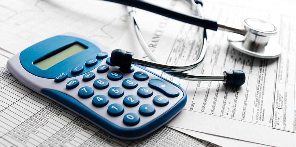 Image of a calculator and a generic medical bill
